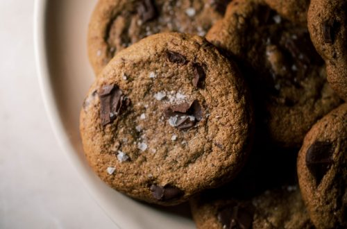 Spelt Chocolate Chunk Cookies on a plate on a countertop.