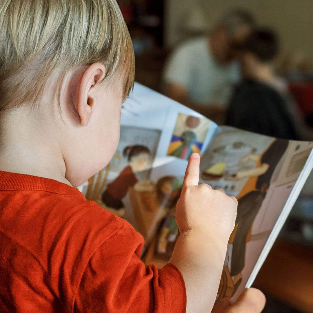 Toddler with a picture book.