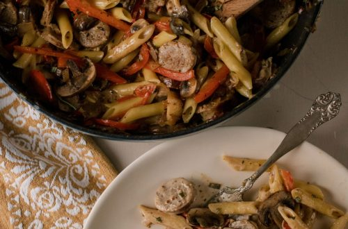 Overhead photo of plate with Creamy Mushroom Penne With Sausage and Red Peppers