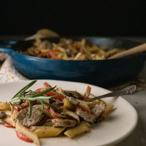 Plate of Creamy Mushroom Penne With Sausage and Red Peppers