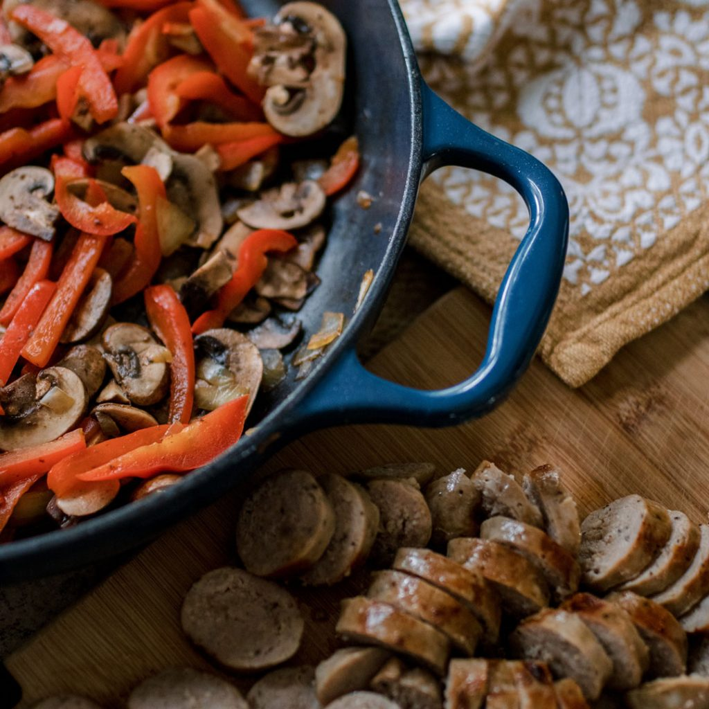Cut sausages for Creamy Mushroon Penne with Sausage and Red Pepper